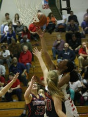 Rossview's Semajia Ogburn goes up for a reverse lay