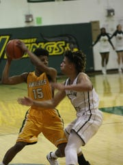 Springfield's Keenan Pulley guards against Northwest's
