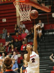 Rossview's Semajia Ogburn (2) goes up for a lay up