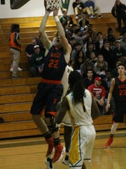 Beech's Nelson Smith (22) puts up a shot against Northwest