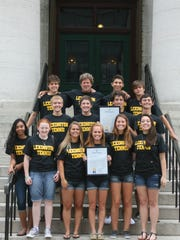 The Lexington High School boys and girls tennis teams, coached by Ron Schaub, were honored by the Ohio House of Representatives in the Ohio Statehouse. Both teams received a tour  and proclamations from State Rep. Mark Romanchuk, R-Ontario, for winning state championships during the 2012-2013 school year.