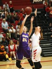 Clarksville's Lainey Persinger (24) puts up a shot