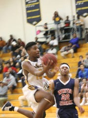 Northeast's Resean Taylor goes up for a shot during