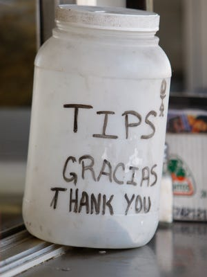 A tip jar at Taqueria Los Poblanos, a taqueria in New Orleans, LA.  There was a recent crackdown on mobile taco stands in nearby Jefferson Parish.  Taqueria Los Poblanos is in Orleans Parish. Photo by Eileen Blass, USA TODAY staff  ORG XMIT: EB 32108 Mobile kitchens 6/18/2007  (Via MerlinFTP Drop)