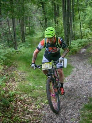 A mountain biker rides at Levis Mound near Neillsville in Clark County.