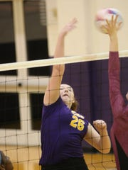 Clarksville High's Gabi Reagan tries to spike the ball