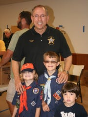 Sheriff Snyder poses with a few Scouts participating