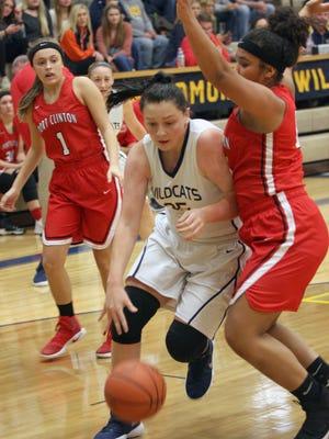 Woodmore's Jordan Nighswander drives to the basket against Port Clinton's Delayna Laurel.