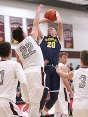 Woodmore's Mithchell Miller tries to shoot over Genoa's Nate Lewis.