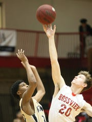 Rossview's Will Midlick goes for the ball against Kenwood's