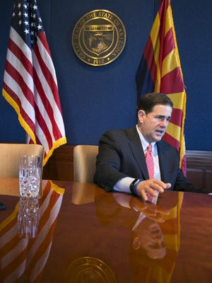 Arizona Governor Doug Ducey during a one-on-one interview with the Arizona Republic at Ducey's office at the Arizona State Capitol in Phoenix on Jan. 5, 2018.