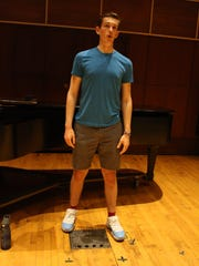 Matthew Goodheart rehearses in Binghamton University's