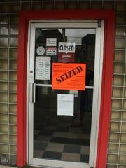Signs posted outside of Grotta Azzurra in Binghamton