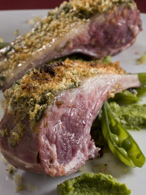 """Rack of lamb with green chile, mint, and sweet pea puree. This recipe is from """"The Food Network South Beach Wine & Food Festival Cookbook,"""" by Lee Schrager with Julie Mautner."""