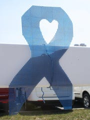 The Family Nurturing Center displays more than 600 blue ribbons on the white fence in front of Tom Gill Chevrolet, at the Florence Freedom baseball stadium and along Ewing Bouelvard in Florence. The blue ribbon became a symbol of child abuse prevention in 1989, when a Virginia grandmother first tied a blue ribbon on the antenna of her van as a symbol to alert her community to this growing epidemic.