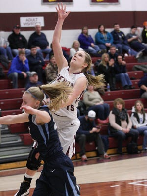 Genoa's Haley Gerke puts up a shot Tuesday in a victory over Lake.