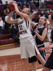 Genoa's Erica Harder puts up a shot Tuesday and is