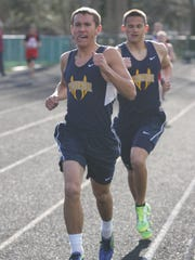 Woodmore's Ryan Avers(front) and Ross Weirich battle for the lead in the 800 meter run.
