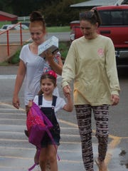 Brooklyn Stanley arrives for her first day of class Monday at Norfork's Arrie Goforth Elementary.