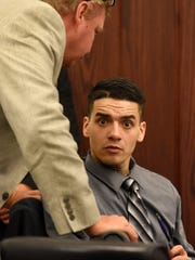 "Suspect Andrew Romero appears during the first day of testimony in his trial in Los Lunas, N.M., Thursday, Sept. 8, 2016. Romero is on trial for the shooting death of Rio Rancho Officer Gregg ""Nigel"" Benner, who shot and killed after making a traffic stop in an Albuquerque suburb."