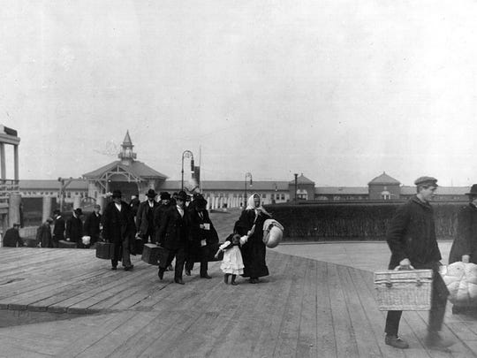 Immigrants arrive at Ellis Island in New York City in 1905.