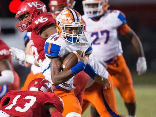 Madison Central's Jimmy Holiday runs the ball during