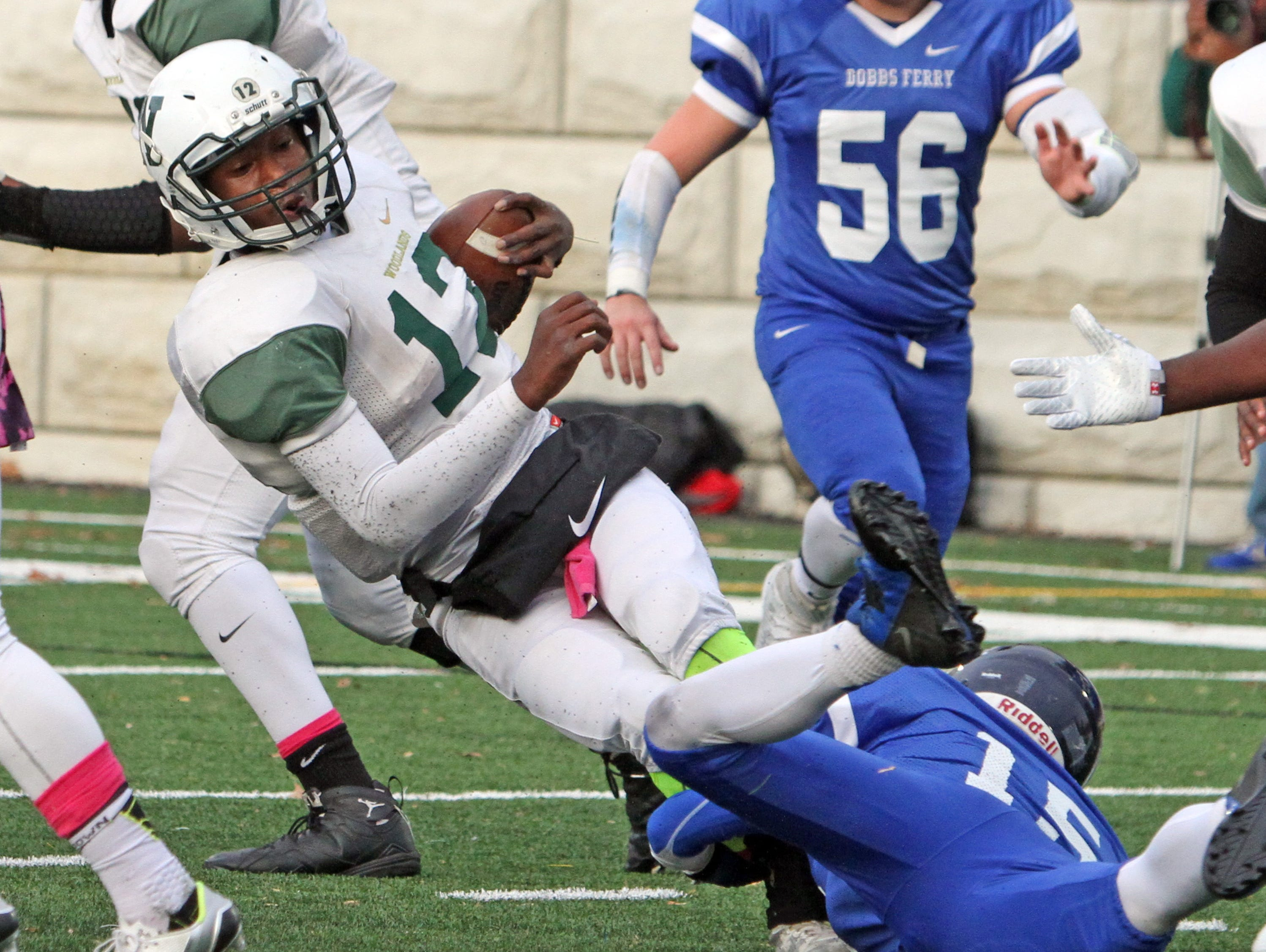 Hadi Darvash of Dobbs Ferry takes down Woodlands quarterback Amari Bilal during the Class C championship game at Pace University Oct. 31, 2015. Dobbs Ferry defeated Woodlands 35-0.