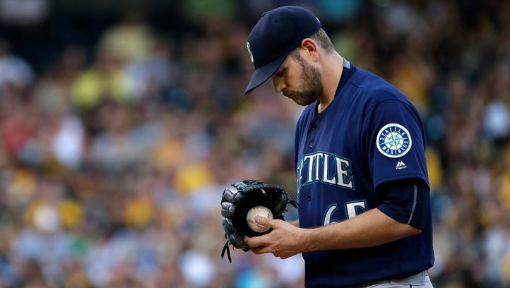 Seattle Mariners starting pitcher James Paxton collects himself on the mound during the first inning of a baseball game against the Pittsburgh Pirates in Pittsburgh, Wednesday, July 27, 2016.