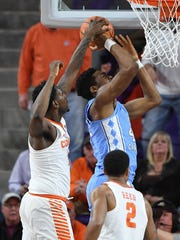 Clemson forward Elijah Thomas (14) blocks the shot