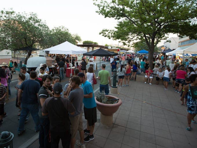 People gather to Downtown Main Street on Wednesday