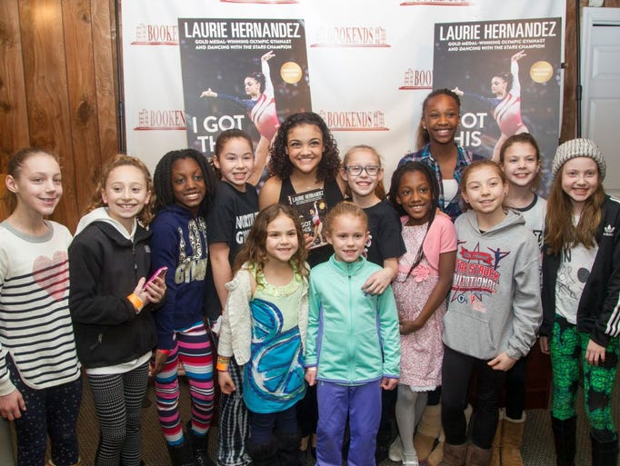 Gold Medalist Laurie Hernandez greets fans and signs