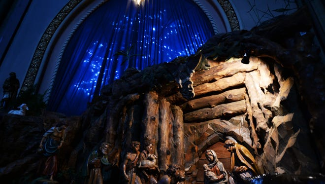 The carved wood nativity scene at the Cathedral of St. John Berchmans.