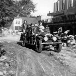 After bulldozers had cleared a path, this Brighton Fire Department truck was among the first firefighting units to pass through Court Street on the scene of an imaginary blaze. Firemen from 10 counties joined in the mock demonstration.