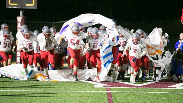 The Patriot football team gets ready for action in