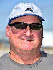 Centerville High School tennis Coach Randy Ecker
