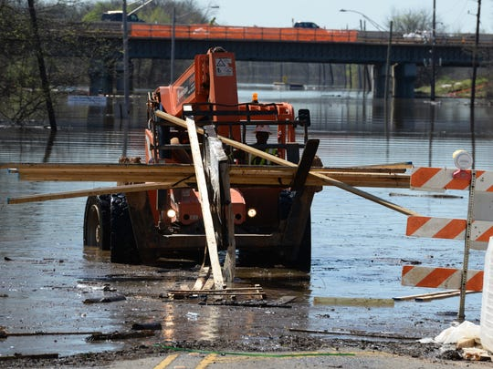 A worker clears debris from Russell Road in Shreveport