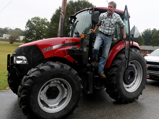 Republican gubernatorial candidate Bill Lee steps off his tractor Oct. 10, 2017, to speak to supporters in Madison County.