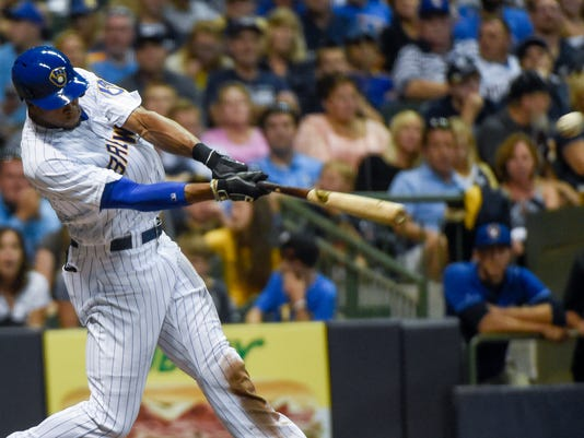Milwaukee Brewers' Keon Broxton hits an RBI double during the sixth inning of a baseball game against the Pittsburgh Pirates on Friday, July 29, 2016, in Milwaukee. (AP Photo/Benny Sieu)