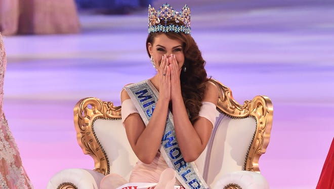 Miss South Africa and the 2014 Miss World, Rolene Strauss, reacts after being crowned during the grand final of the Miss World 2014 pageant at the Excel London ICC Auditorium in London on December 14, 2014.