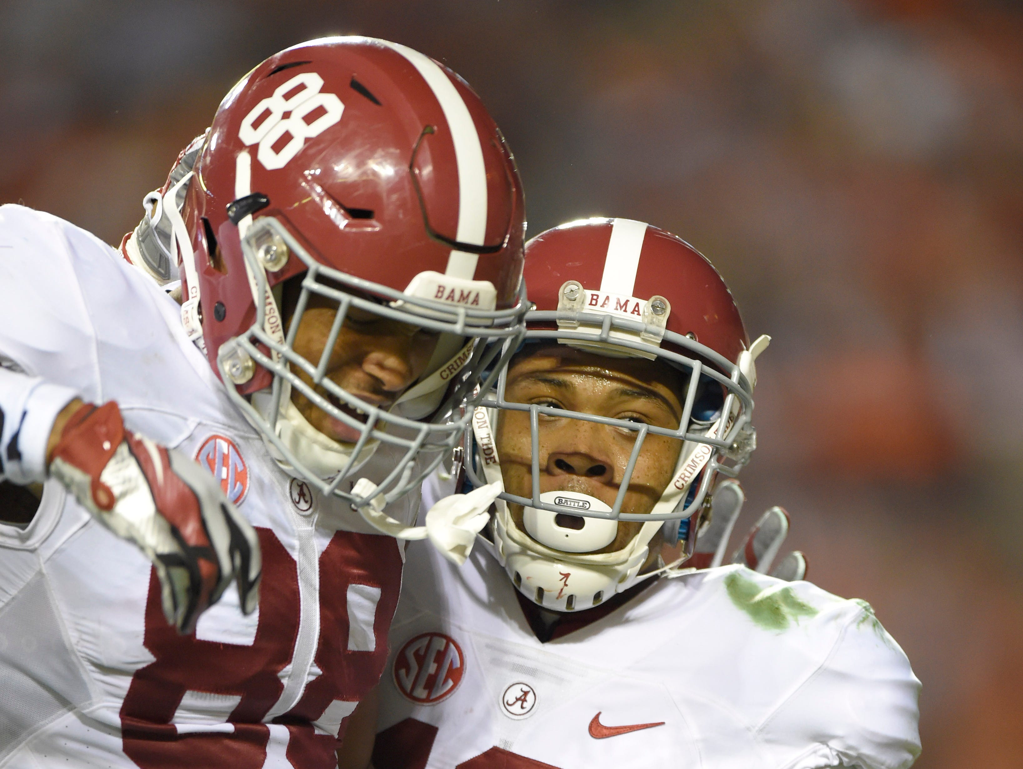 Alabama wide receiver ArDarius Stewart (13) celebrates his 34-yard touchdown pass with tight end O.J. Howard (88) on Saturday.