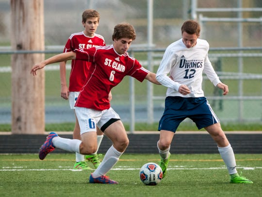 St. Clair's Ben Al-Gharabally gets past Marysville's Logan Atkinson during a soccer game Wednesday, Oct. 12, 2016 at Marysville High School.