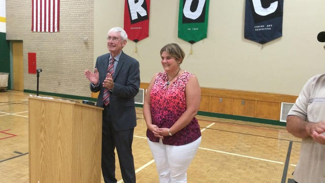 State schools Superintendent Tony Evers applauds Pamela Gresser after he announced Thursday that she was named the Wisconsin Elementary Teacher of the Year.