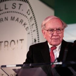Warren Buffett, Chairman and CEO of Berkshire Hathaway and Co-Chairman of Goldman Sachs 10,000 Small Businesses Program, speaks during a press conference where it was announced that Detroit was named the 11th city to be included in the $500 million Goldman Sachs initiative November 26, 2013 at Ford Field in Detroit, Michigan.