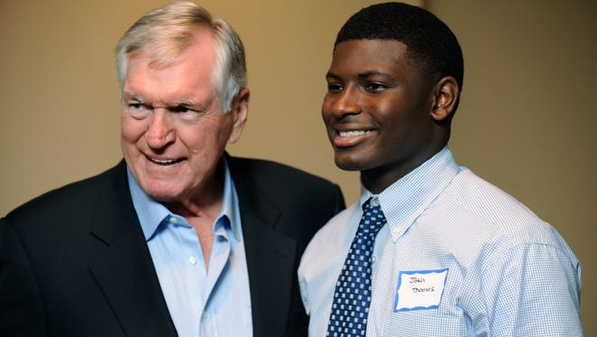 Lee Roy Jordan, left, meets Josh Thomas as he greets football fans at the Montgomery Quarterback Club at the Montgomery Country Club in Montgomery, Ala. on Tuesday October 7, 2014.