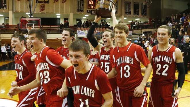 The Twin Lakes Indians celebrate after defeating McCutcheon 52-50 to win the final of the J&C Hoops Classic Saturday, December 3, 2016, at Lafayette Jeff.