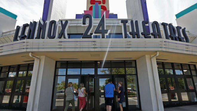 """Moviegoers attend the first day of movies since before the pandemic began at AMC Lennox in Columbus on Thursday. The theater was offering 15-cent admission for newer releases such as """"Sonic the Hedgehog"""" and """"Black Panther"""" and some older classics, such as """"Grease"""" and """"Ghostbusters."""""""
