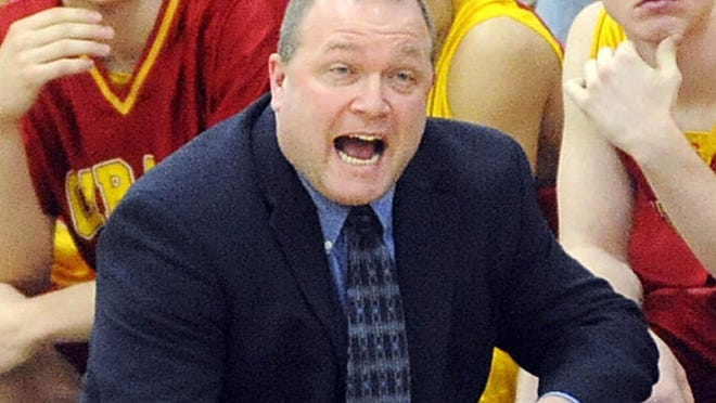 Girard basketball coach Darrin Mayes shouts instructions to his team during a December 2009 game.