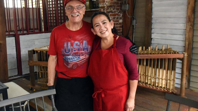 Husband and wife team Don and Joice LeFleur stand in the outside patio of their new restaurant on Main Street in Somersworth named Indo U.S. Cuisine. They have always had a dream of opening their own restaurant because they both like to cook so they are combing Indonesian culture and food with a touch of American.