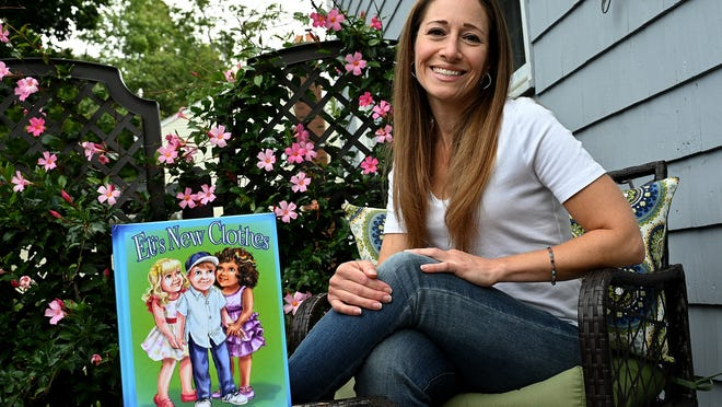 "Holliston mom Kerri Mullen wrote her children's book, ""Eli's New Clothes"" to help parents and others learn more about gender identity."