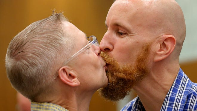 Bart Peterson (left) and Peter McNamara celebrate after exchanging wedding vows inside the City County Building on June 25.